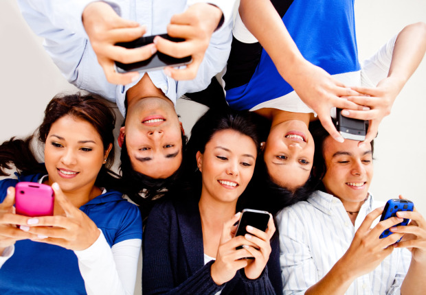 young-people-texting-on-phones-m